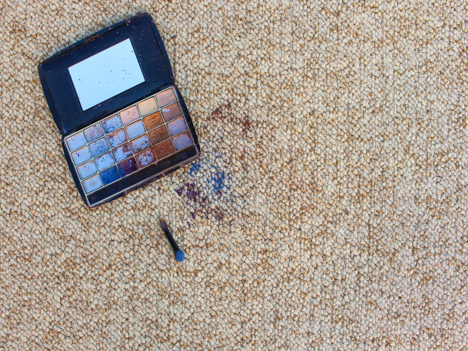 Eye shadow fell and scattered on carpet