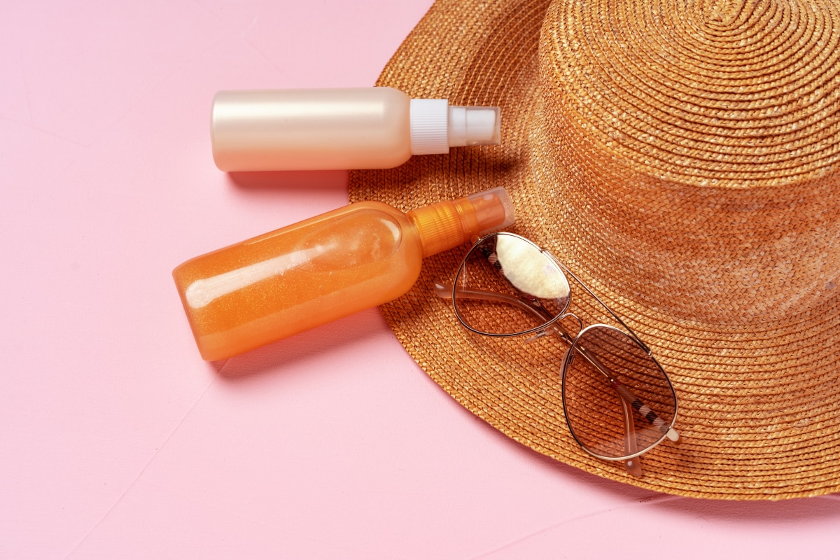 tanning oil and straw hat